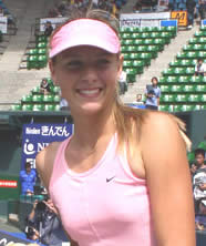 Maria smiling because she's wearing pink no doubt